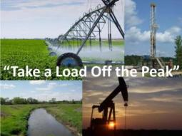 Take A Load Off The Peak. Irrigation system, country road, drilling equipment shown in photo.